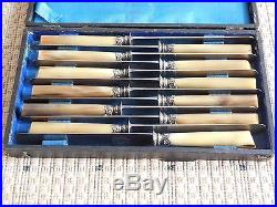 Set of 12 Old French knives horn handles sterling silver ferrules mark TD PARIS