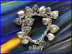 Vintage Sterling Silver Repousse Puffy Heart Charm bracelet. Marked 925